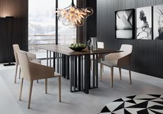 The traditionally warm feel of the Spitalfields Dining Table's walnut top gives way to modern aesthetic with twin architectural aluminum bases in graphite metallic finish.