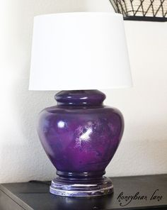 Purple lamp with an old-world style distressing