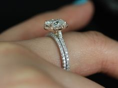 This is it but with the more tear shaped middle band! - Tabitha & Petite Bubbles 14kt Gold Pear FB Moissanite and Diamonds Halo TRIO Engagement Ring (Other metals and stone options available) http://www.charleskoll.com/product-category/wedding-bands/