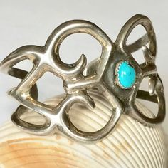 Vintage Navajo Sand Cast Sterling Silver and Turquoise Cuff Bracelet... Circa 1940's   sugardrawers.etsy.com