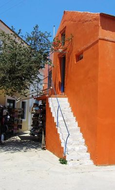 Orange house with white stairs in Fiscardo village, Kefalonia island, Ionian sea, Greece White Stairs, Orange House, Places To See, Greece, Fair Grounds, Island, World, Travel, Landscapes