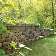 Building a retaining wall. How gorgeous would a short wall be around the front…
