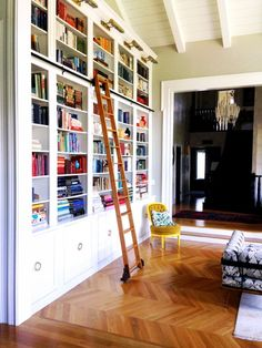 Floor-to-Ceiling Bookcases with Ladder//Moving in Together? 9 Decorating Tips for Couples