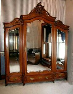Antique French Victorian Walnut Armoire,this Antique Victorian triple door armoire with beveled glass mirrors and carved crest is French. It was made circa after the style of Louis XV. It is a lovely piece that dates from the late century and w Furniture Ads, French Furniture, Unique Furniture, Bedroom Furniture, Furniture Buyers, Furniture Stores, Outdoor Furniture, Furniture Price, Ikea Outdoor