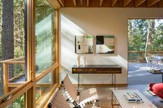 Douglas fir cabinetry and composite wood flooring are among the earthy finishes that help tie the home to its context. Big Sheds, Indoor Slides, Georgian Townhouse, Warehouse Conversion, Corten Steel, Japanese House, Home Goods, David, Washington