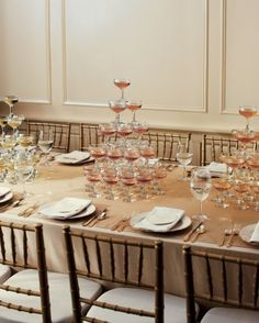 A Refreshing Tablescape Elegant and indulgent, these Champagne towers only look expensive. When constructed with rental coupes (these are from Party Rental Ltd., partyrentalltd.com) and filled with one of our tasty, reasonably priced suggestions, they cost less than many floral centerpieces. Or, use flickering candles in place of Champagne. Plus, with this clever tablescape, you don't need waiters to descend with glasses before the toast -- and there's plenty for seconds.