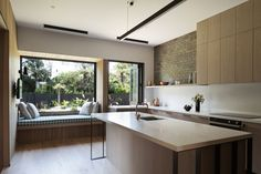 Window seat and kitchen ideas for town House House Under Eaves in New Zealand by MRTN Architects. House Eaves, Kitchen Interior, Kitchen Design, Kitchen Ideas, Timber Walls, Level Homes, Architect House, Cuisines Design, Interior Architecture