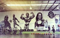 Bad ass massive gym mural from @howes.dis of me and a few of my iconic buds who've inspired generations over the years. Rock, Jordan, Arnold, Rich Froning and Ronda. #JordanDunkinOnMe #BloodSweatAndRespect #FirstTwoYouGive #LastOneYouEarn