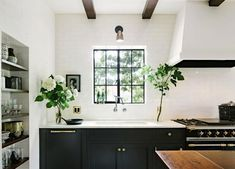 Beautiful flowers in black and white kitchen