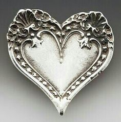 Heart brooch crafted from old silver spoon handles