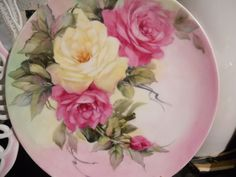 Yellow and ruby roses  hand painted by June Watson