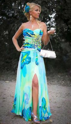 """I wore this dress to the wedding of my friend. Thank you Tony!""  Tony Girl Mirka, a makeup artist from Slovakia looks stunning in her TONY BOWLS EVENINGS. Love prints? Then check out TONY BOWLS EVENINGS, Style No. TBE11450. See it here: http://tonybowls.com/evenings/evening-dresses/tbe11450/?fc=23"