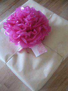 Tissue paper flower bows!  http://www.nashvillewrapscommunity.com/blog/how-to-videos/how-to-make-tissue-flowers/