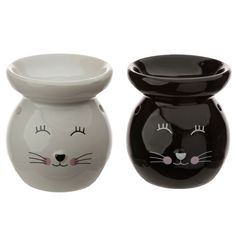 Our range of oil burners covers a huge selection of designs and colours and whether you are using them as decoration or for infusing your home with fragrance, they are great value for money. As with all our oil burner items, they come with full safety information which we recommend you read before use. They are suitable for fragrance oils and are not recommended for use with wax melts or granules. Single item, random colour supplied. Height 10cm Width 9cm Depth 9cm (approx 4 x 3.5 x 3.5… Ceramic Oil Burner, Burner Covers, Oil Burners, Cat Face, Cat Gifts, Wax Melts, Fragrance Oil, Colours, Ceramics