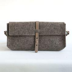 taupe wool felt clutch/small bag Uppsala.   #bag #bags #messengerbag  #smallbag #handmadebag #opdewallen #dutchdesign #woolfelt #wool #leather #adlersewing #tas #vilt #wol #wolvilttas #leather #studiorowold #rowold #bagmaking #vilttas #taupe #taupemelee #craftsmanship #walkingfoot #handmadeinamsterdam