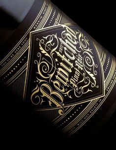 ETCHED and/or USE ON LABELS for fall bottling. Beautiful typography and wine label. I love the way all the gold stands out against the black. Design by Stranger & Stranger Cool Typography, Typographic Design, Graphic Design Typography, Lettering Design, Logo Design, Vintage Lettering, Branding Design, Wine Label Design, Bottle Design