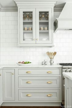 Looking for some grey and gold kitchen inspiration? Here's a sneak peek at our grey and gold kitchen renovation + the images that inspired me! Two Tone Kitchen Cabinets, Kitchen Cabinet Design, Kitchen Redo, Interior Design Kitchen, New Kitchen, White Cabinets, Kitchen Ideas, Kitchen Cabinetry, Colored Cabinets