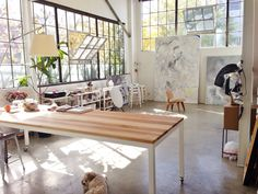 Industrial loft studio space with raw wood tabletop #workspace