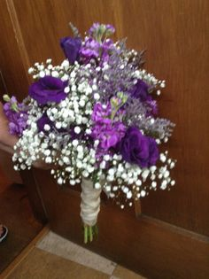 beautiful purples..lisianthus,baby's breath..dark blue moon dianthus, purple stock and caspia...by Flowers by Tammy..Greeneville, TN 423-636-1000