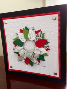 Wreath Christmas Card, with a music theme, using left over paper from another project. Wreath cut with Stampin Up Builder Bird Punch.