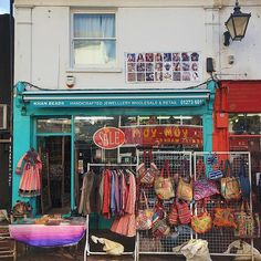 The calm after the Storm Doris... Business as usual at this Indian emporium in the North Laine.   TIP: In case you don't know what they sell, check the extra signage above the canopy for clarification!  #Brighton #thisisbrighton #sydneystreetart #smallshops #morocco #bags #doors #rainbow #india #lovebrighton #travel #wanderlust #shops #travelblogger #storefrontcollective