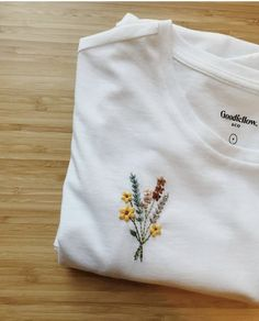 Made to order hand embroidered tshirt with flower bouquet over pocket Indian Embroidery Designs, Embroidery On Clothes, Embroidery Flowers Pattern, Couture Embroidery, Embroidered Clothes, Embroidery Fashion, Hand Embroidery Designs, Embroidery Stitches, T Shirt Embroidery