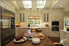 Suzie: Amazing Spaces - Gorgeous kitchen with side by side skylights, ivory kitchen cabinets ...