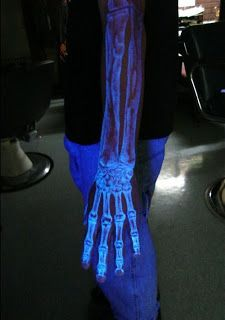 "Art-Sci: Tattoos that are Invisible in Daylight.  Above: A clever UV tattoo of the bone structure beneath the skin of the hand and arm. Biological tattoos such as this one, where the bone is ""exposed"", are an excellent use of white UV ink."