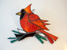 This beautiful home decor is made from red glass with orange streaks, green, dark brown and white glass. It catches lots of reflections. Absolutely stunning in the window or as an ornament, but also great as a wall decor. It is made using the Tiffany copper foil method. Decorative