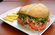 lomito completo (roast pork sandwich with sauerkraut, tomatoes, avocado and mayonnaise)