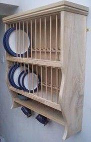 Plate racks...  http://theplaterackco.com/info_warwickshire_rack_oak.html