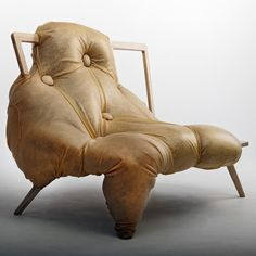 At One by Charlotte Kingsnorth This latex covered sofa from British designer Charlotte Kingsnorth kind of looks like a swamp monster swallowed the chair. Definitely furniture with a life of its own. Sofa Chair, Armchair, Chair Design, Furniture Design, Muebles Art Deco, Unusual Furniture, Trendy Furniture, Smart Furniture, Leather Furniture
