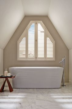 Natural shades of wood, stone and cream create a calming spa like feel in a bathroom. Made-to-measure shutters are a perfect way to finish this look off and add a little bit more privacy. Wooden Shutters, Waterproof Blinds, Made To Measure Blinds, Paint Shades, Bathroom Renos, Bathroom Ideas, Upstairs Bathrooms, Window Dressings, Bath