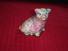 "Attentive glazed #paper_mache #pig VGU   This little fellow appears to be sitting up to keep an eye on something   The sticker on the bottom reads:  •#808 DANIEL •L. E. Products •Oakville, Ontario •Canada   This item measures 4 3/16"" (10.6 cm) high x 3"" (7.6 cm) deep (snout to back)   A cute little companion that is good for decoration or a low maintenance pet    09292011RITT54A"