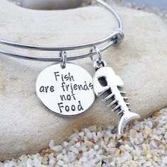 OUR STORY: At KK&Whimsy, we love incorporating personalized elements into our style! We know that each of our clients have a unique story and have walked a unique journey that ultimately created who they are at their core. Our hand stamped jewelry is a tribute to your life, your family and all the things you love.  ITEM DESCRIPTION: This Finding Nemo bangle is made of a 3/4, 20 gauge nickel disc and is hand stamped with the phrase Fish are friends not food. It is coupled with a Tibetan…