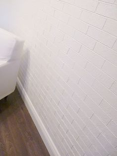 """Faux brick wall  - 2 gallon pails of interior stucco  - 1/4"""" painting tape (4 rolls for this particular wall)  - Piece of cardboard  - Ruler  - Pencil  - Exacto blade  - T.S.P. solution  - Fine sandpaper and sanding block  - Large dry-wall trowel  - Sea-sponge  - Putty knife or small dry-wall trowel  - Chalk-line  - A partner (this is a definitely a 2 person operation)"""