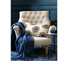 Create your own cozy corner with a classic upholstered armchair. Toss in a soft throw and a plush pillow, and you have all the ingredients for a perfect reading nook.