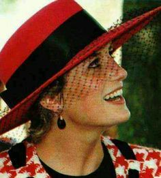 Don't you think veils add a bit of mystery to my hats?: Beautiful in red.
