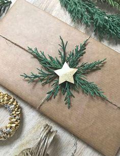 Geschenke verpacken und mit Tannengrün schmücken #giftwrapping