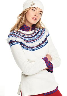 Subtle fringe and statement snowflakes add a touch of whimsy to a traditional Fair Isle sweater.