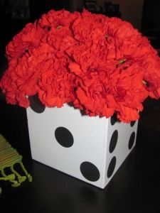 """White vase dotted to make it """"dice"""" topped with carnations. $20.00"""