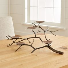 Sale ends soon. Graceful tree limb stretches realistic-looking branches of hand-wrought iron, studded with disks to support a flowering of pillar candles. Perfect for creating a warm, rustic and classic fall table. Wooden Candle Holders, Lantern Candle Holders, Candle Stand, Fireplace Candle Holder, Crate And Barrel, Barrel Table, Modern Rustic Decor, Rustic Design, Home Decor Vases