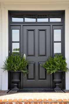 Classic black and white entry with perfect potted ferns in urns black classic entry ferns perfect potted urns white Best Front Doors, Beautiful Front Doors, Black Front Doors, Modern Front Door, Painted Front Doors, Front Door Design, Front Door Colors, Modern Entrance, Wood Front Doors