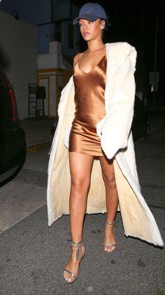 Bronze slip dress with a white duster coat + baseball cap.