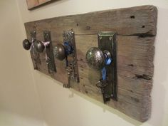 Great idea for hanging or just a conversational piece. I used 2 vintage doorknobs with faceplates, cleaned them up and screwed them into a nice piece of barnwood, added the keys on ribbon for finishing touch