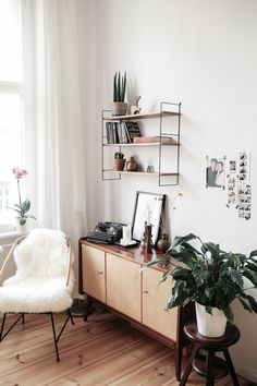 Shelving and a credenza in a fab mid-century inspired home in Berlin. Herz & Blut. My Scandinavian Home.