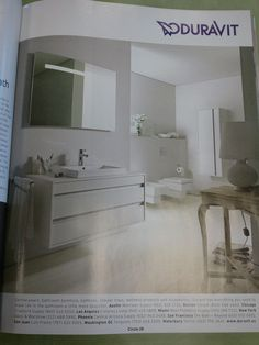 Duravit: mirror with light, cabinet on far wall, towel bar on the side of the vanity...