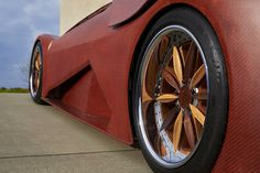 Even the wheels are extraordinarily complex. The floating spokes are carved out of walnut and ash.