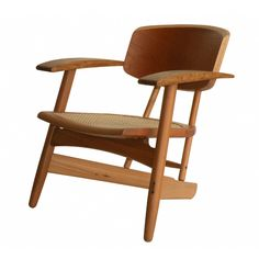 """Designed by Fernando Mendes, Sergio Rodrigues' nephew and disciple, the """"Santos Dumont"""" armchair is mindful in traditional and innovative design. Referring to 1950's aesthetics, in its lines and forms, Mendes' goal is to create a well-designed piece that will last indefinitely, as evident in the """"Santos Dumont"""" armchair's utmost craftsmanship."""