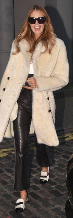 Who made  Elle Macpherson's white coat and black zebra print handbag?